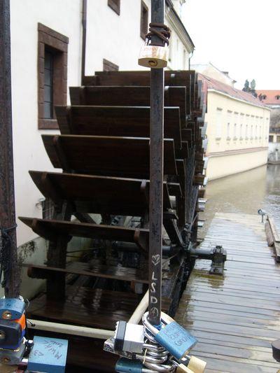Padlocks on metal by water wheel