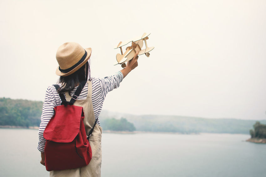 Dream Freedom Happiness Plane Relaxing Travel Day Girl Hat Holding Leisure Activity Lifestyles Nature Outdoors Play Real People Standing Toy Vocation Water Adventures In The City