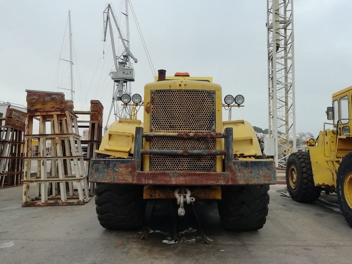Commercial Land Vehicle Construction Equipment Construction Industry Construction Site Day Development Industry Land Vehicle Machinery Metal Mode Of Transportation Nature No People Occupation Outdoors Sky Stationary Transportation Truck Wheel Yellow