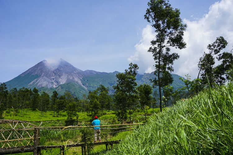 Enjoy the beauty of Merapi Volcano Holiday Java Merapi Volcano Nature Vacations Adventure Beauty In Nature Cloud - Sky Environment Green Color Indonesia_photography Land Mountain Mountains Nature Outdoor Outdoors Plant Real People Sky Summer Tourism Travel Destinations Tree Volcano