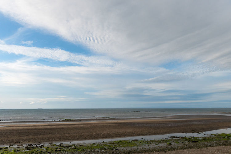 the tide slowly going out revealing more of the beach Sky Water Sea Scenics - Nature Cloud - Sky Land Beauty In Nature Beach Tranquility Tranquil Scene Horizon Horizon Over Water Nature Day Non-urban Scene No People Sand Idyllic Outdoors