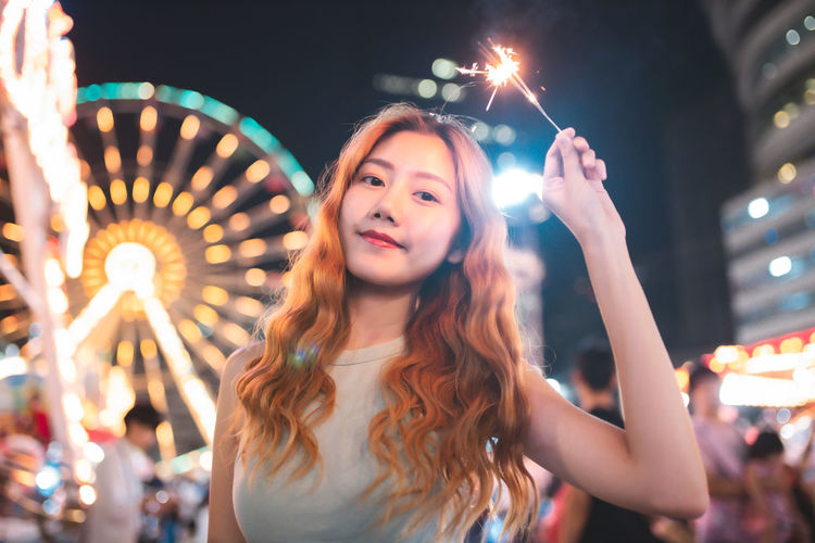 Portrait of a young woman in amusement park