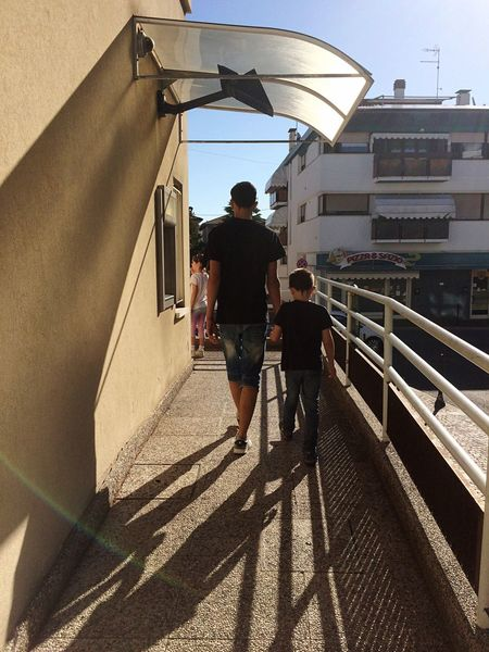 Architecture Real People Built Structure Two People Walking Sunlight Rear View Togetherness Building Exterior Lifestyles Leisure Activity Steps And Staircases Siblings Black Tshirt Morning Walk Shadow Men Steps Full Length Bonding Day Outdoors