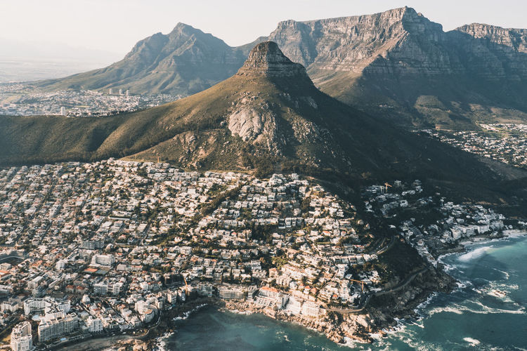 Exploring Cape Town from above is the absolute best! Cape Town Cape Town, South Africa TRVEL Table Mountain Aerial Aerial View Destination Helicopter View  Lionshead Mountain Mountain Range Ocean Outdoors Top View Travel Destinations My Best Travel Photo