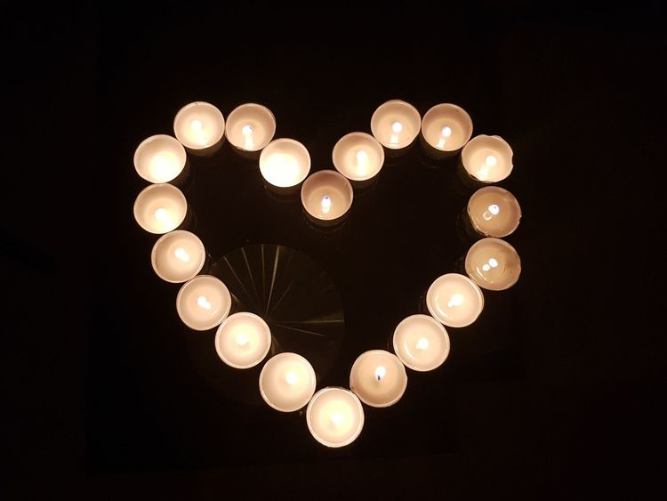 Heart of candles Death Funeral Valentine Heart Love Tealights Black Background Representing Illuminated Lighting Equipment Hanging Close-up Sky