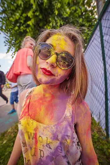Portrait of happy girl wearing sunglasses