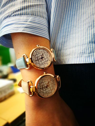 Close-up of woman wearing wristwatches
