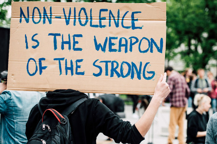 Non-Violence Protest Quotation Quotes Sign Slogan Strong Text Violence Weapon What We Revolt Against Up Close Street Photography Resist