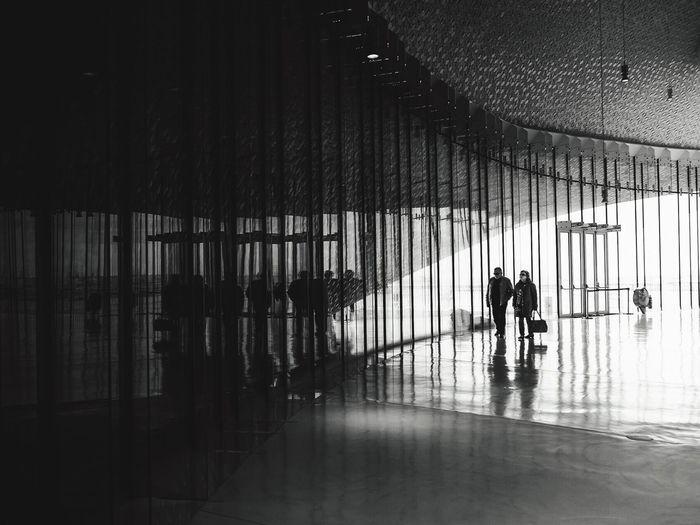 Full length of man walking in corridor