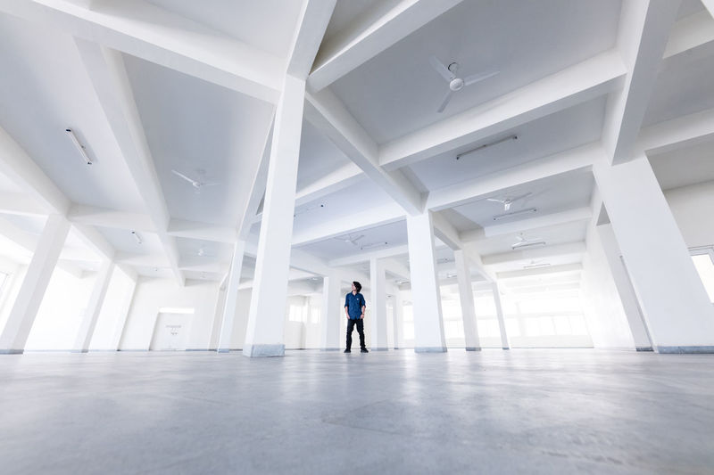 Man Standing In Empty Building