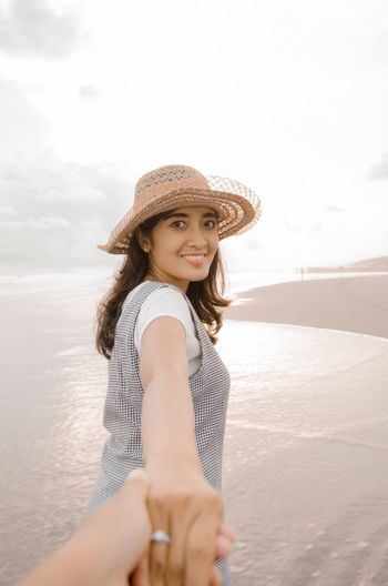 Vacations Women Beach Hat Sea Leisure Activity Water Real People Lifestyles One Person Smiling Nature Sun Hat Young Women Outdoors Day Portrait Happiness Sky Young Adult Vacations Looking At Camera Love Is Love
