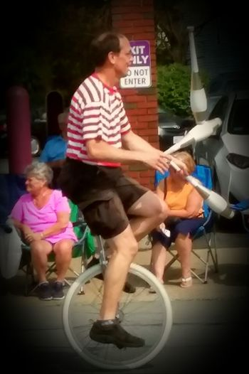 Full Length Adult People Differing Abilities Outdoors Parade Time Unicycle Unicyclist  Unicycle Tricks Unicycling Unicycling And Juggling