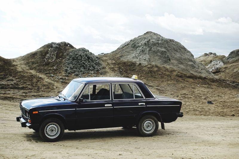 Old, darkblue lada parking in the desert