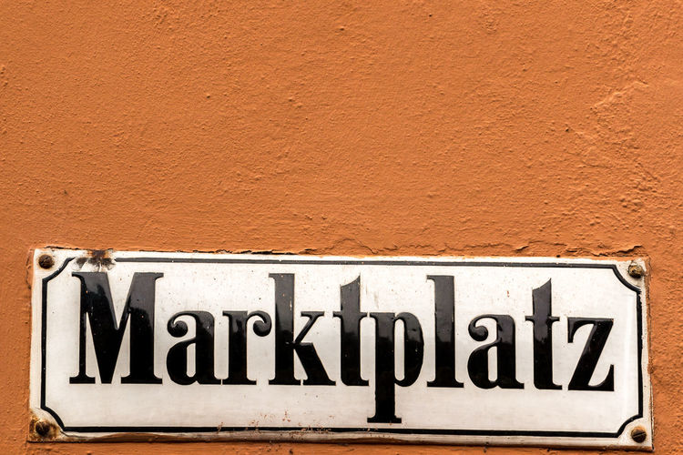 German sign for marketplace on the outer wall Text Communication Wall - Building Feature No People Architecture Western Script Built Structure Sign Close-up Day Single Word Wall Building Exterior Copy Space Capital Letter Outdoors Number Old Information Brick