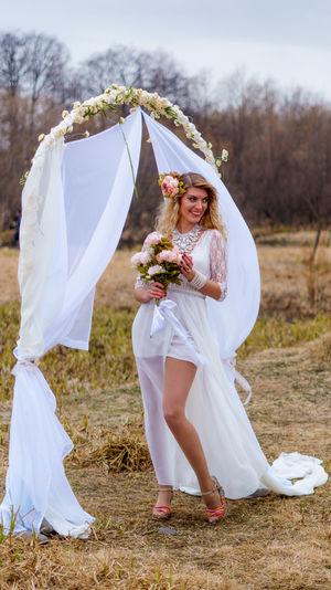 Full length of bride standing on field