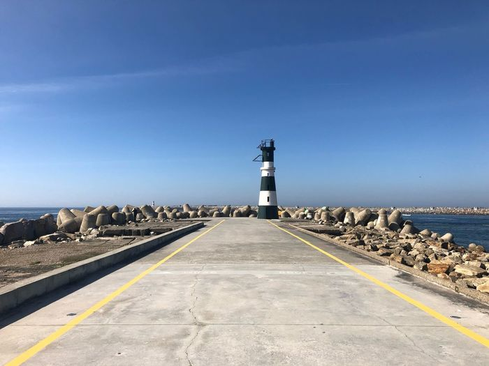 Without filters 👌 17.62° Barra, Aveiro Light House And Blue Sky Light House Praia Da Barra Portugal Sky Road Direction Sign Day Road Marking Clear Sky No People The Art Of Street Photography