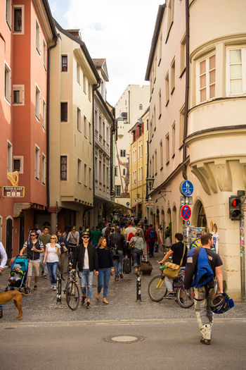 People walk on a busy street in the pedestrian area of Regensburg Adult Architecture Bicycle Building Exterior Built Structure City City Life Day Large Group Of People Leisure Activity Lifestyles Men Outdoors People Real People Residential Building Road Street Transportation Women
