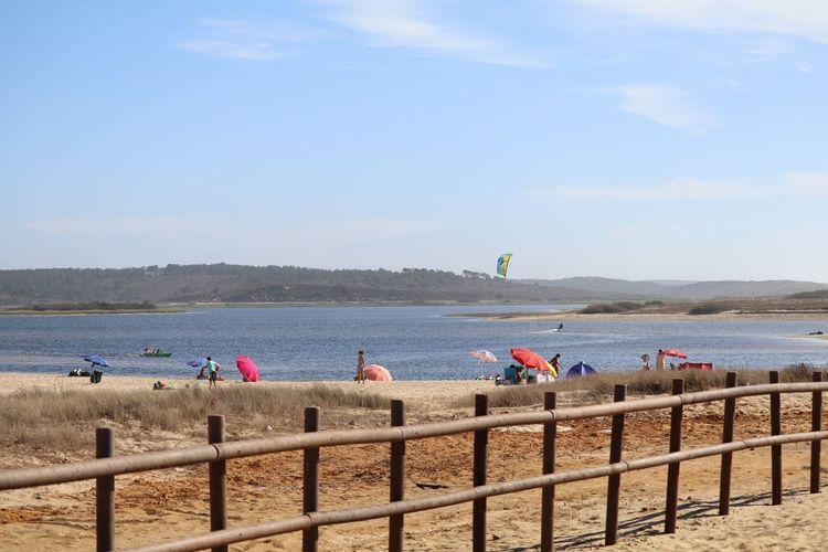 Fence at lagoa de santo andre against sky
