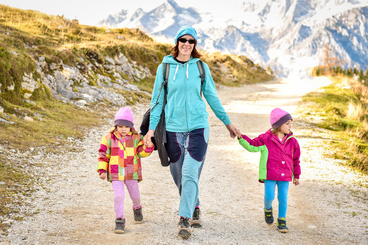 Active Active Family Active Lifestyle  Bonding Child Childhood Daughter Elementary Age Family Family Family With Two Children Father Full Length Girls Hike Hiking Leisure Activity Mother Mountains Mountaneering Trekking Portrait Togetherness Trekking Trekking Nature Love Warm Clothing