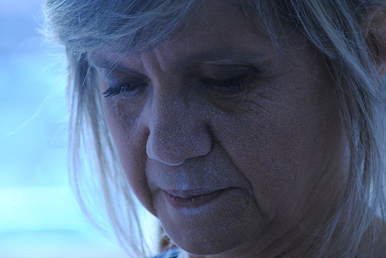 Close-up of mature woman looking down