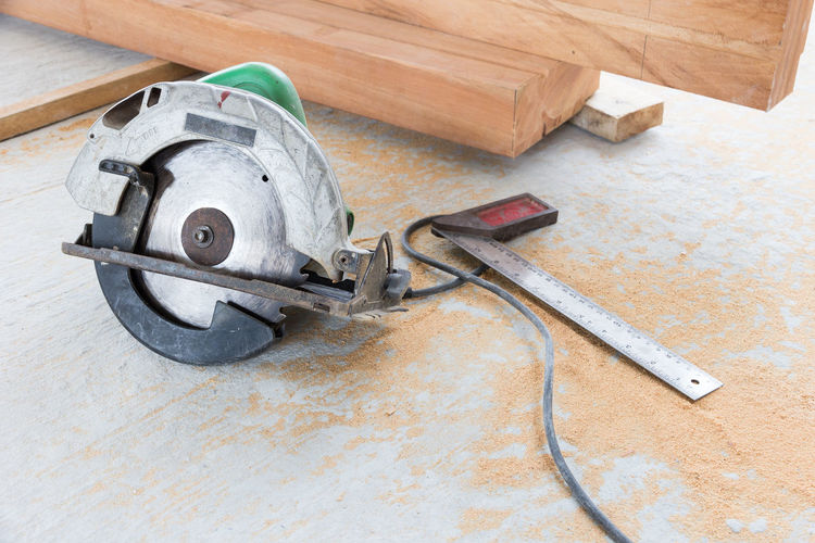 High angle view of circular saw on floor at construction site