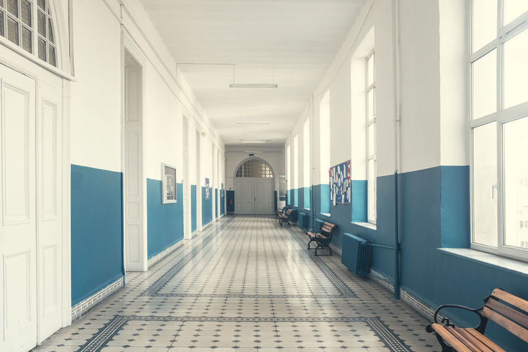 Architecture Arcade Corridor Building Indoors  The Way Forward Direction Flooring Built Structure Ceiling Empty Window Day Diminishing Perspective Hospital Architectural Column Tiled Floor No People