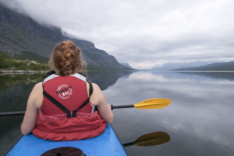 Active Woman Beauty In Nature Kayaking Kayaking In Nature Kungsleden Lake Leisure Activity Lifestyles Mountain Nature Outdoors Scenics Tourism Tranquil Scene Tranquility Vacations Water Women Women Kayaking Young Women The Great Outdoors - 2017 EyeEm Awards Summer Exploratorium #FREIHEITBERLIN