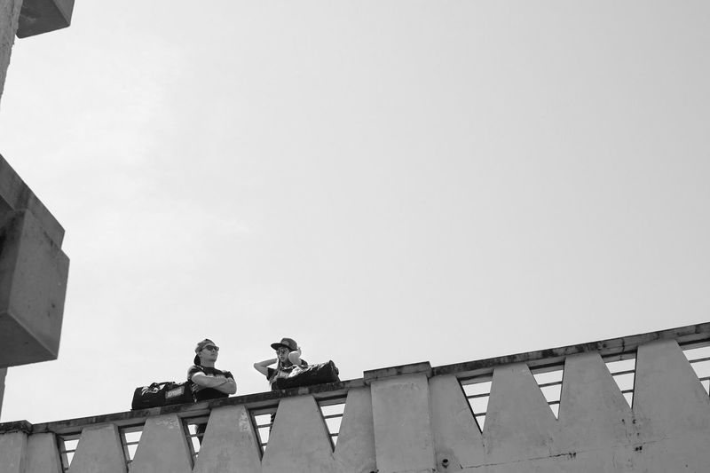 Couple Friend Black & White Architecture Black And White Blackandwhite Building Exterior Built Structure Clear Sky Copy Space Day Low Angle View Outdoors Roof Sculpture Sky Statue Working