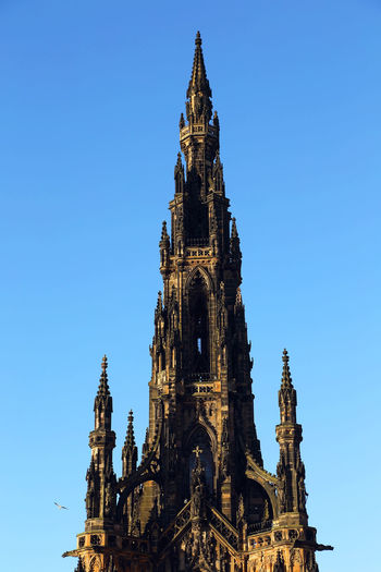Low Angle View Of Scott Monument Against Blue Sky