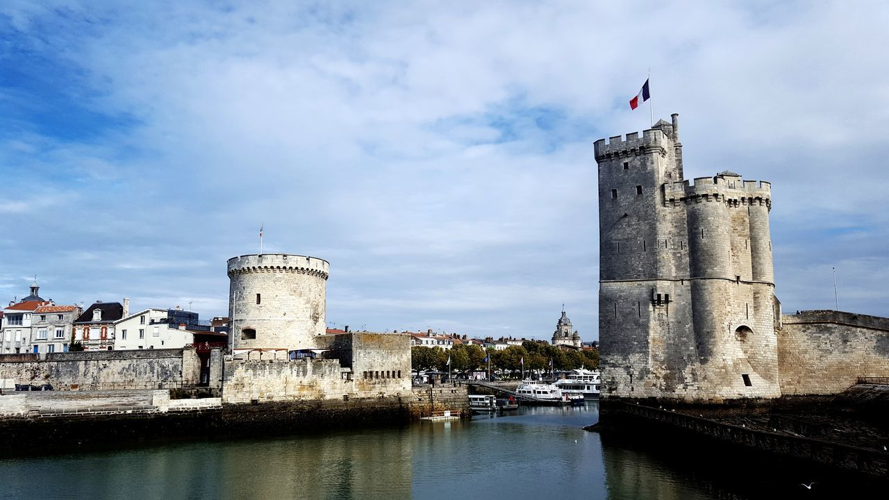 La Rochelle La Rochelle La Rochelle, France City Water Sky Architecture Building Exterior Cloud - Sky Urban Skyline Historic Tower Tall - High National Flag Cityscape