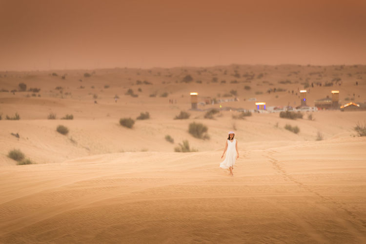 Portrait in Dessert of UAE. Dessert Dubai Portrait Of A Woman Travel Travel Photography UAE Adult Arid Climate Beauty In Nature Climate Desert Emirates Environment Full Length Land Landscape Motion Nature One Person Outdoors Portrait Sand Scenics - Nature Sky Standing Sunset Tranquility Walking Women Young Adult