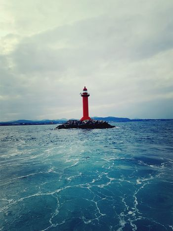 A red light house Lighthouse Travel Destinations Direction Sea Nautical Equipment Building Exterior Horizon Over Water Day Sky Outdoors Scenics Nautical Vessel Water Harbor Beauty In Nature Travel Photography Jeju Island, Korea Beautiful ♥ Life Is Good Eyeemphotography Architecture Travellers