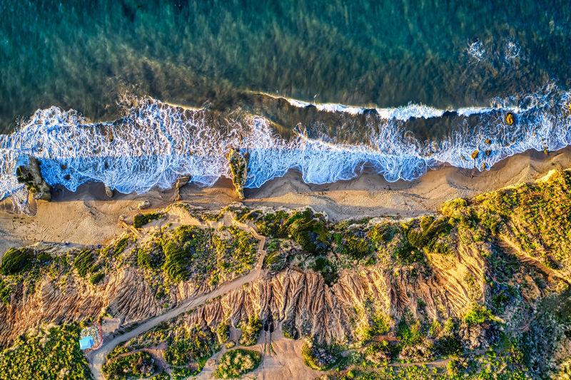 Panoramic shot of rocks by sea