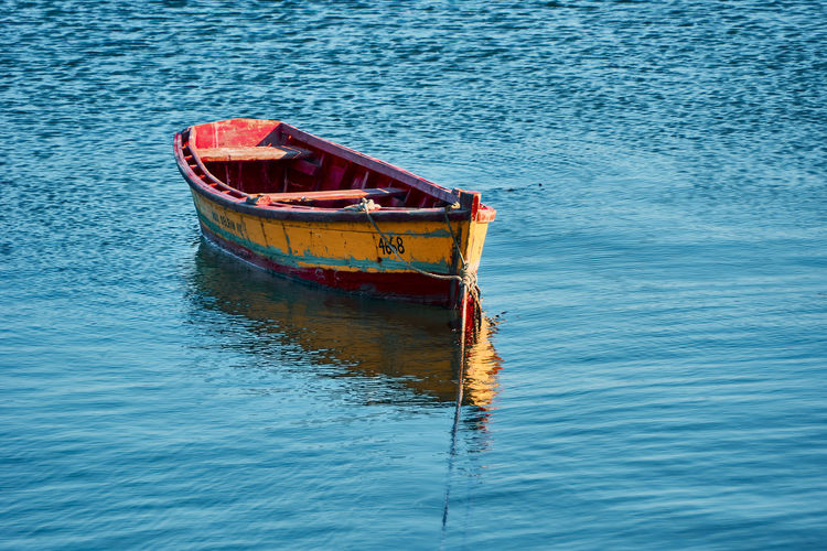 Seascape... Nautical Vessel Water Mode Of Transportation Transportation Sea Waterfront No People Day Moored Rippled Nature Abandoned Outdoors Blue Tranquility High Angle View Reflection Travel Red Anchored Sinking Fishing Boat Rowboat Scenics Seascape