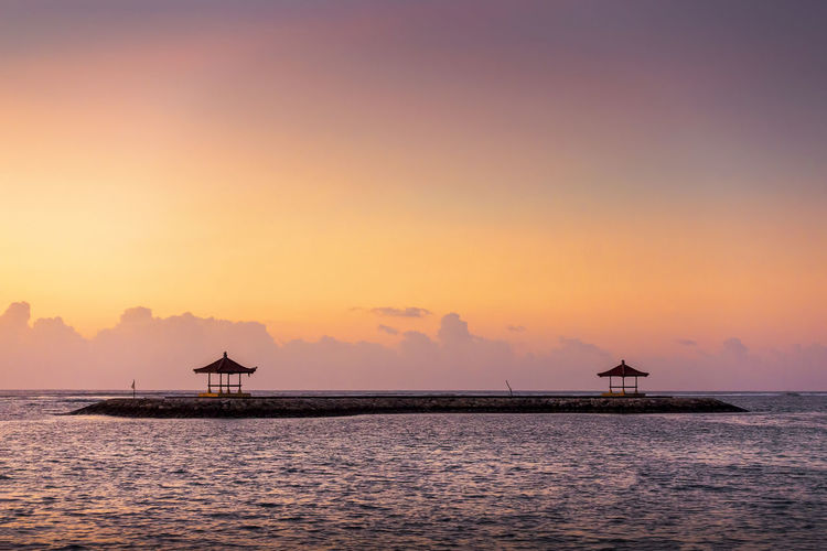Beautiful Scenery at Karang Beach, Sanur, Bali, Indonesia Bali, Indonesia Beach Photography Pagoda Relaxing Architecture Beauty In Nature Cloud - Sky Idyllic Nature No People Orange Color Outdoors Sanur Beach Scenics - Nature Sea Silhouette Sky Sun Sunrise Sunset Tranquil Scene Tranquility Travel Destinations Water Waterfront