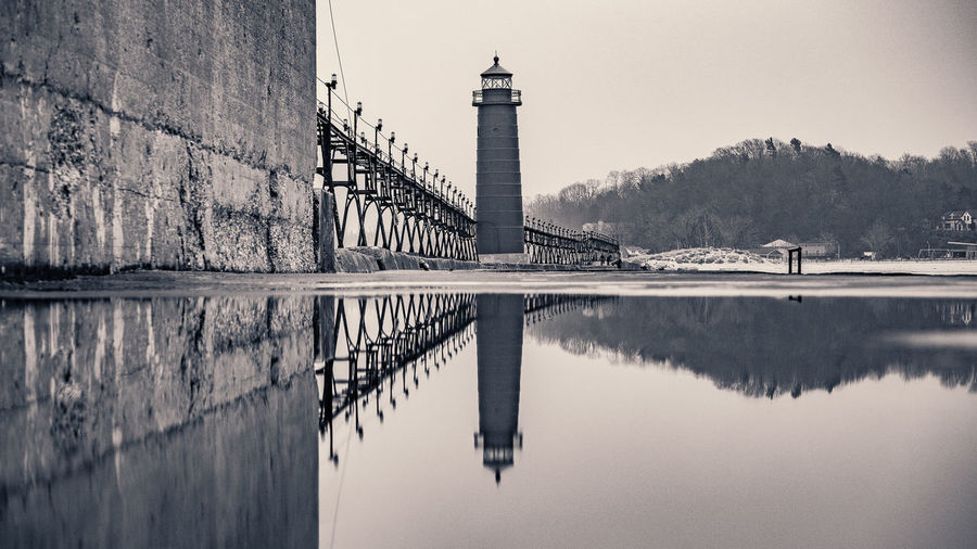 Architecture Blackandwhite Building Exterior Built Structure Connection Engineering Exterior Horizontal Symmetry International Landmark Long Monochrome Outdoors Pier Puddle Puddleography Railing Reflection Showcase: January Water Waterfront