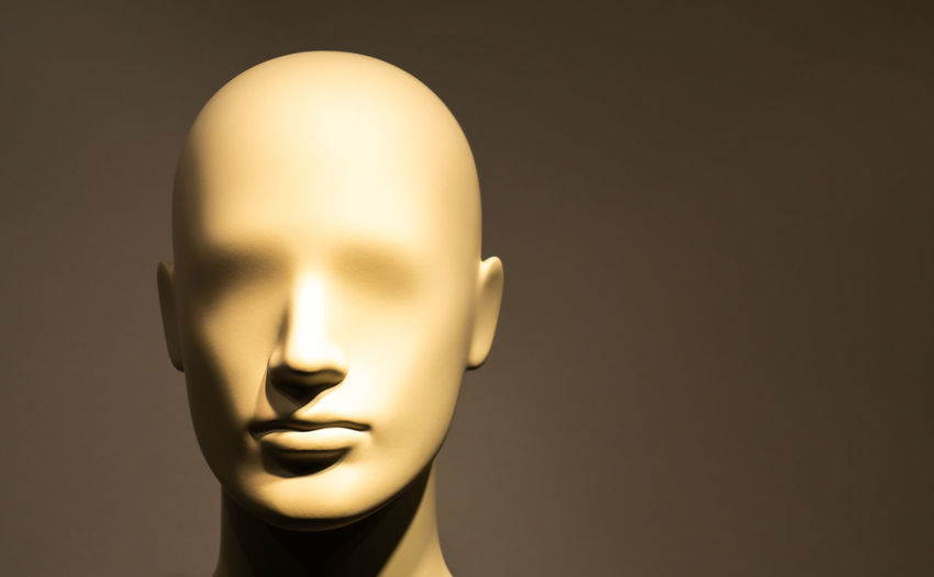 Close-up of mannequin against gray background