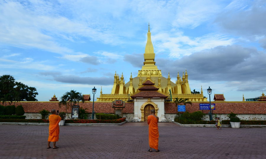 Monks near Pha That Luang stupa. Vientiane. Laos Place Of Worship Stupa Vientiane Architecture Belief Buddhism Buddhist Temple Building Building Exterior Built Structure Gold Colored History Laos Monks Outdoors Pagoda Pha That Luang Pha That Luang Laos Real People Religion Southeastasia Spirituality The Past Travel Destinations Vientiane Laos