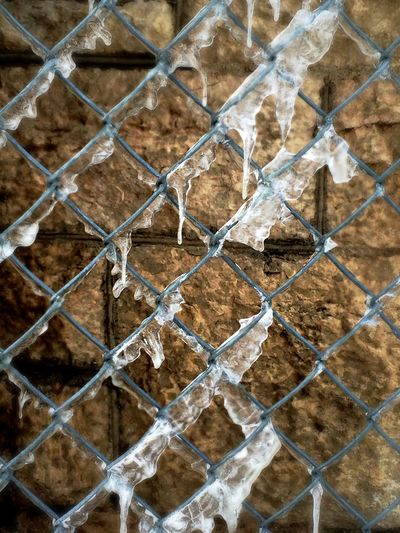 Pattern Pieces Close-up EyeEm IPhone Iphoneonly Happy Fence Friday EyeEm Best Edits Chainlink Fence Metal Fence Frozen Water Limestone Architecture Limestone Heritage Building Textures And Surfaces Water Eye4photography  Streetphotography Light And Shadows