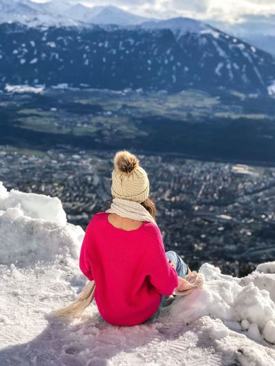 Go Higher Warm Clothing On The Edge Sitting Alone Pink Sweater Warm Clothing Mountain Range View From Above Cityscape Austria Tyrol Alps One Person Mountain Nature Rear View Beauty In Nature Sitting Women Real People Rock - Object Leisure Activity Outdoors Tranquility Scenics Vacations Tranquil Scene Lifestyles One Woman Only Shades Of Winter