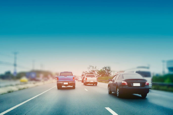 Car driving on street at sunset,Transportation on road concept Cars Cinematic Driving High Way Road Traffic Blue Sky Car Clear Sky Day Land Vehicle Mode Of Transport Nature No People Outdoors Parked Parking Road Sky Street Streetphotography Transportation Tree Uban Way