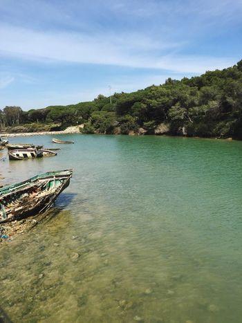 SPAIN Conil Conil De La Frontera Harbour Old Ship Boots Cemetery Turquoise Blue Water Non-urban Scene No People Alone Summer Blue Sky Sea Lake