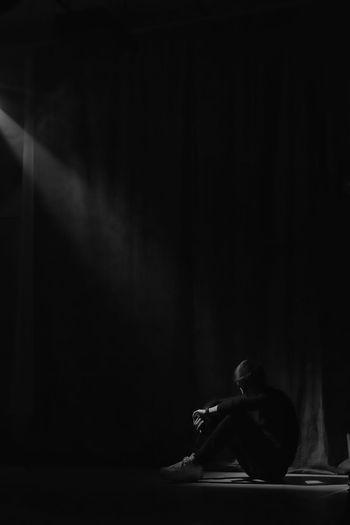 Man sitting in the dark room