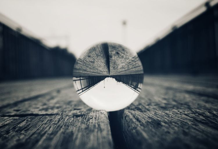 Close-up of umbrella on wooden table