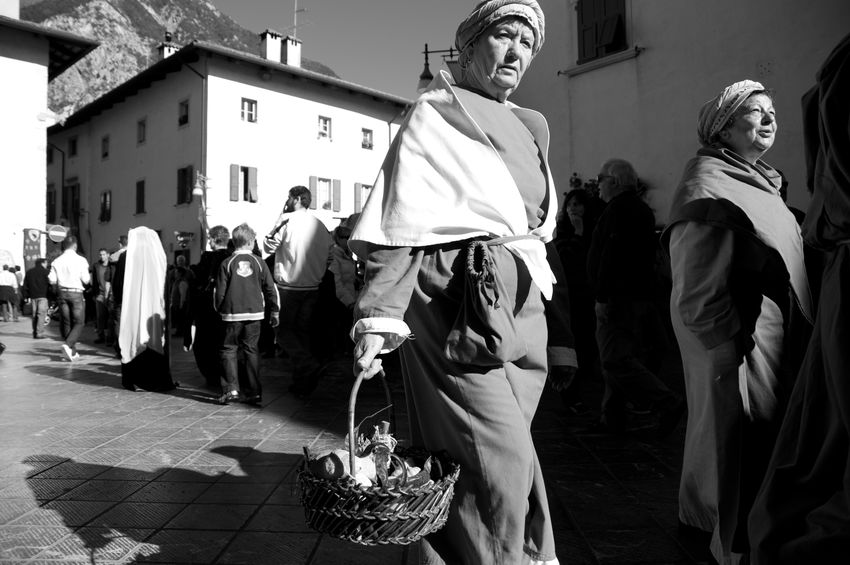 portrait of a women wearing medieval clothing during the parade Festa della Zucca Arts Culture And Entertainment Blackandwhite Photography Historical Parade Medieval Clothing Outdoors Parade People Portrait Of A Woman Real People Streetphotography Urban Landscape Welcome To Black