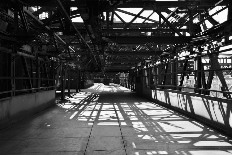 In the old steel mill Architecture Built Structure Indoors  No People Building Industry Day Absence Factory Direction Warehouse Ceiling Empty Domestic Room The Way Forward Sunlight Abandoned Shadow Roof Roof Beam Tiled Floor Bnw_friday_eyeemchallenge Bnw_corridor