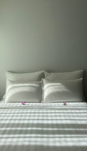 Close-Up Of Empty Bed In Bedroom