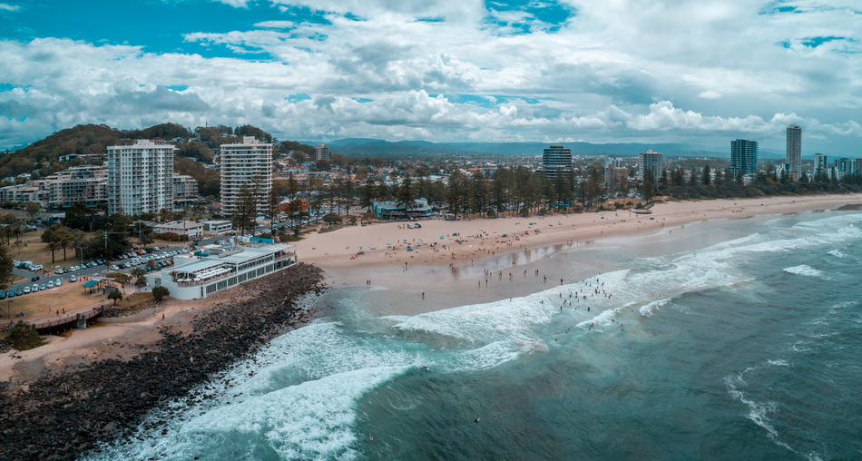 Aerial panorama of beach cafe and people enjoying the beach at burleigh heads, queensland, australia