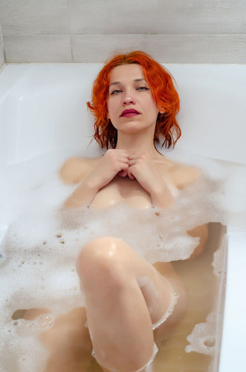 Beautiful young woman in bathroom