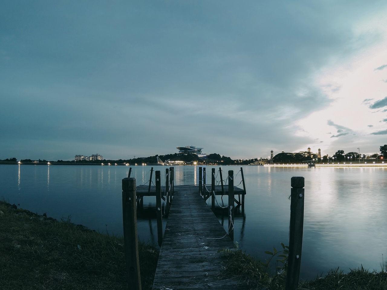 Pier On Lake Against Sky At Dusk